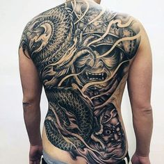 Man With Samurai Mask And Coiled Snake Full Back Tattoo
