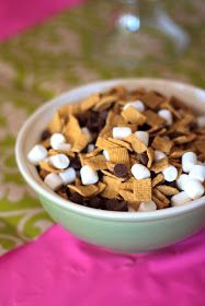 S'mores mix for camping Birthday Party, making this and putting it in bags for the kiddos to take home.