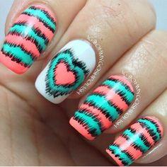Teal and coral nail design
