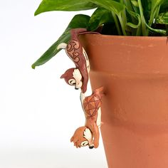 Amazon.com: Disney Traditions by Jim Shore 4016552 Chip and Dale Garden Pot Hanger 4-1/4-Inch: Home & Kitchen