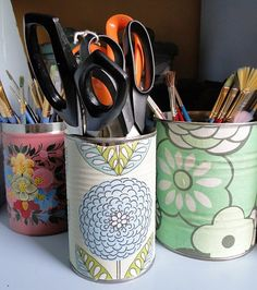 DIY old soup cans for pencil holders, flower vase, kitchen tool holder, etc. Use recycled cans, all you need is scrapbook paper and mod podge or glue