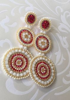 Beadwork triple disc seed bead post earrings. If you like bold, statement jewelry, you will love these gorgeous earrings. I created these stunning earrings with beautiful shades of red, tan and cream 11/0 and 8/0 seed beads. Each bead is individually expertly woven to make these beautiful