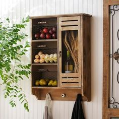 This Wood Wall Cabinet with Baskets and Hooks is the ideal combination of style and storage! #Kirklands #homedecor
