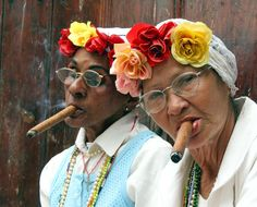 one of my favorite people ever was my great grandmother, abuelita Meve. A cigar smoking triplet born and raised in Cuba. I can still hear her. flower wearing gandmas of cuba We Are The World, People Of The World, Havanna Party, Cuban Women, Smoking Ladies, Photo Portrait, Cuban Cigars, Fidel Castro, Cigar Smoking