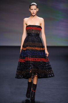 I cannot pinpoint it, but I love this dress-- maybe because it looks like it is made of pipe cleaners, a crafting material that I cannot make work (Christian Dior, Fall 2013 Couture)