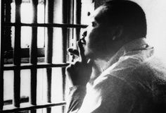 Civil rights leader Martin Luther King Jr. sits in a jail cell at the Jefferson County Courthouse in Birmingham, Alabama. October 1967.