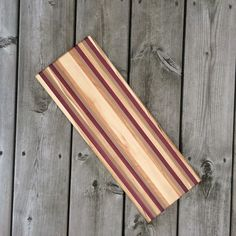 These Kingston-made cutting boards are 100% handmade. Each board is made with mix of different kinds of wood, such as Purple Heart, Cherry, Mahogany, Walnut, Maple, Ash and Spanish Cedar. These different colours are combined to create stunning handmade cutting boards. Perfect on their own, or purchase with the artisan's bread knife to make a lovely gift set. #YGK #home #handmade #kitchen #food #foodie #wood #gift