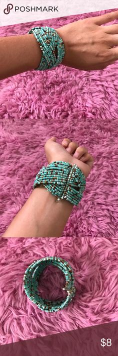 Turquoise beaded bracelet Bought his at forever 21. Thick, beaded turquoise colored bracelet. Cuff style Forever 21 Jewelry Bracelets