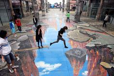 A woman appears to jump across a yawning chasm in this huge piece of 3D art on a street in China.