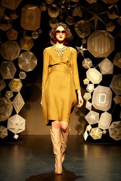 The handmade DIY look of the geometric gems & stars backdrop of Tia Cibani's F/W 2013 runway show at New York Fashion Week