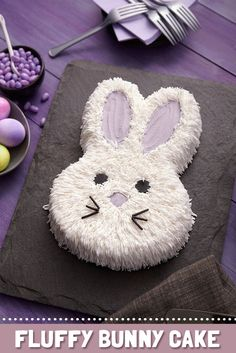 Use a grass tip to cover your bunny cake in fur!