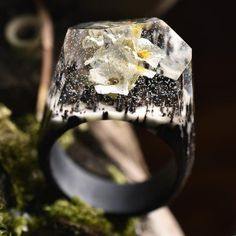 Ethereal White Flower While snow may cover the earth, the keen eye will still find these unearthly fine winter flowers. This ring is made of clear resin and wh