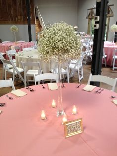 Mounds of baby's breath on tall Eiffel vases. All inBloom Flowers, Columbus OH