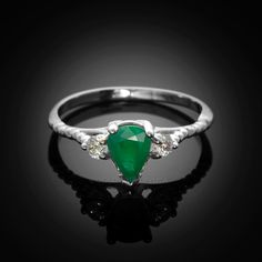 White Gold Rope design stackable ring with teardrop shaped Emerald and Topaz accents. Ring weight: 2 g. Stackable Rings, White Topaz, White Gold Rings, Promise Rings, Emerald Green, Heart Ring, Band, Stone, Metal