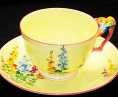 Crown Staffordshire Flower-Handle HOLLYHOCKS Tea cup and saucer