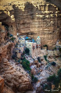 """St. George's Monastery """"is located in Wadi Qelt, in West Bank not far from Jericho. The monastery was started in the 6th century, and is of Greek Orthodox religion. Approaching the monastery, you must first descend the deep gorge, cross a small bridge, then climb the steps to the monastery."""" 