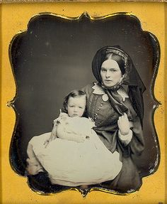 1/6 daguerreotype of  beautiful Victorian mother and her daughter or son. Excellent depth contrast and reflective quality. It looks like her ribbon is blowing in the wind. once again the soft focus adds to the beauty of this image.