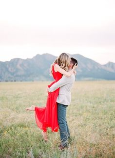Outdoor Natural Light Boulder Engagement with red dress | Connie Dai Photography