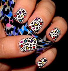 I used Color Club White for the base, then used OPI Black Onyx and Konad plate m57 for the leopard print. Then I used a dotting tool and Chi...