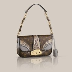 Pochette  The Pochette in Monogramissime combines iconic Monogram canvas with sumptuous alligator and python trimmings to truly glamorous effect. And with rich golden brass, it's a luxurious statement in style.