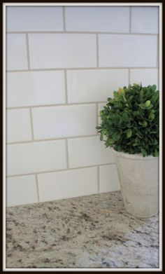 I'm thinking white subway tile with grey or tan grout for my kitchen backsplash.