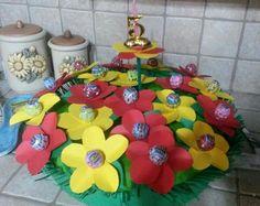 Torta con fiori di lecca lecca