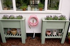 pair of sage green standing raised planters with pink garden hose under window - perfect for adding height or screening, adding greenery to a patio or balcony and to create an easier way to grow herbs or flowers for those who have issues with mobility. #diy #diygarden #planter #diyplanter #diyraisedplanter #raisedstandingplanter #raisedbed #raisedbeddiy #uk Raised Planter Beds, Raised Beds, Outdoor Greenhouse, Outdoor Gardens, Growing Herbs, Growing Vegetables, Pink Garden, Diy Planters, Bold Colors