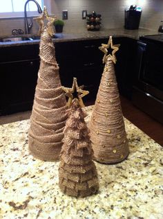 Burlap Christmas cone trees made from poster board, burlap/twine, and hot glue gun. Easy and cheap!