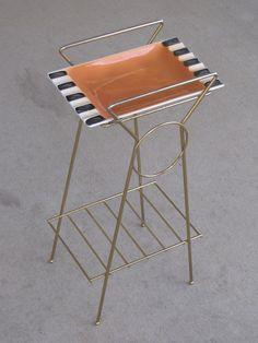 SALE Vintage Mid Century Orange Ceramic Ash Tray with metal stand. $26.99, via Etsy.