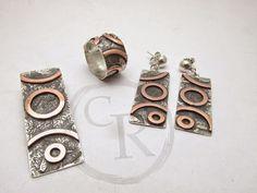 Conjunto de plata con aplicación de cobre, técnica resudado y envejecido.