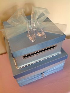 Cinderella Card Box Tutorial For Quinceaneras. A simple project that you can do at home with your friends and your guests will fall in love! Dont forget the glass slippers is must on a Cinderella-inspired card box! Get more ideas at . Sweet 16 Centerpieces, Sweet 16 Decorations, Quince Decorations, Quinceanera Decorations, Quinceanera Party, Quinceanera Dresses, Cinderella Baby Shower, Cinderella Sweet 16, Cinderella Theme