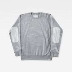 Deze sweater van zware, rulle jersey heeft heel veel details die kenmerkend zijn…