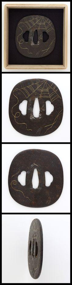 Edo Spider web is engraved on iron Aori-style iron Tsuba with gold color. It is unique design tsuba