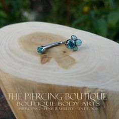 14g titanium J-curve style jewelry featuring Mint Green CZS with White Opals! Jewelry from Anatometal!