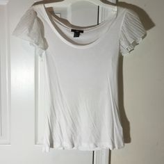 H&M SCOOP NECK TOP White H&M detailed polyester sleeves with viscose body. A pretty top to dress up in with dress pants or skirt. Has sheer flowing ruffle sleeves. H&M Tops Blouses