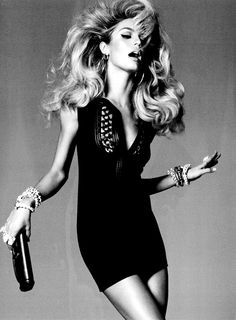 "Big 80's-style hair. Love it.    Candice Swanepoel by Steven Meisel, Vogue Italia, February 2011 (""I Want Candy"")"