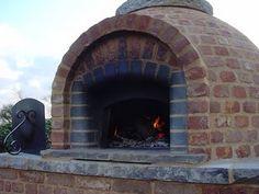 Brick Oven - love those rounded edge bricks