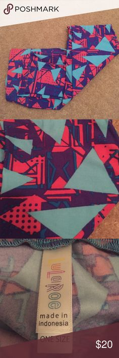 Lularoe Leggings Never worn, Lularoe Leggings, with triangles and squares. Displaying colors of sea foam, pink, blue, and purple. Perfect for the teachers out there. Price is non-negotiable LuLaRoe Pants Leggings