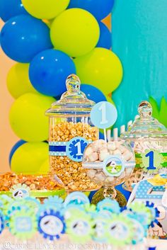 Boys first birthday, candy jars decoration, balloons, playful puppy Boy First Birthday, Boy Birthday Parties, Dessert Bars, Dessert Table, Blue Candy Buffet, Dog Baby, Birthday Candy, Colorful Candy, Party Desserts