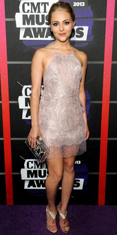 At the CMT Music Awards, AnnaSophia Robb shimmered in a soft pink-beige Georges Chakra halter mini dress, crystal-encrusted B Brian Atwood T-strap heels and a boxed clutch.