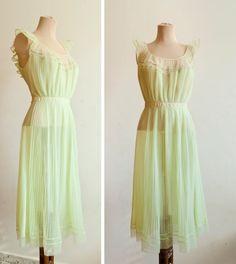 50s Sheer Green Ruffled Sleeveless Romantic Plisse Dress. €48.00, via Etsy.
