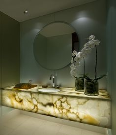 Powder Room - Muted marine aqua palette with a lit back onyx floating vanity commanding calmness to the space.
