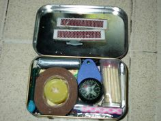 Simple enough to make with an empty Altoids tin:  matches  matchbox  gum  small flashlight  fishing line  duct tape  b-day candle  small candle  small compass  foil  ziploc  safety pins  wire  medical tape  gauze  bandaids  alcohol wipes  plastic container  tire puncture repair patch  needle  thread  signal mirror  rubber band  dental floss  razor blade  safety pins