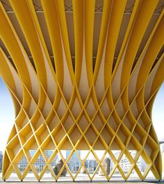 """designboom magazine: """"a woven glulam timber construction creates a bold entryway to the austrian center vienna, built by local wood specialists buchacher…"""""""