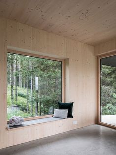 In the living room, a large window frames views of the pine forest in the north. Tagged: Living Room and Concrete Floor. Photo 13 of 17 in A Silvery Gabled Home Cantilevers Out Amid the Austrian Alps. Mini Chalet, Retreat House, Modern Mountain Home, Forest House, Concrete Floors, Alps, Building A House, Modern Design, Interior Design