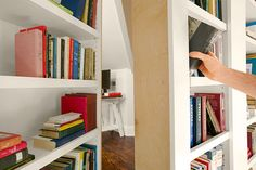 A hinged section of this bookcase serves as a secret secondary entrance to the finished attic office.