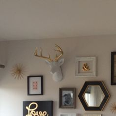 We are loving this gold & white gallery wall! The XL Alfred, our XL white deer w/gold antlers, looks beautiful in this clean space!