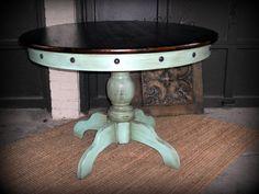 Turquoise pedestal table. Dark top