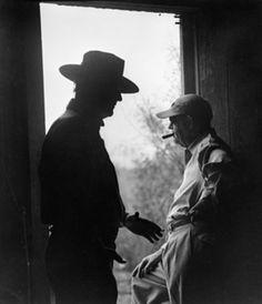 "THE ALAMO (1960) John Wayne & veteran film director John Ford on the set of ""The Alamo"" near Brackettville, Texas - Publicity Still."