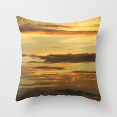 yellow, blue, pink, mountains . Sunset on a throw pillow.